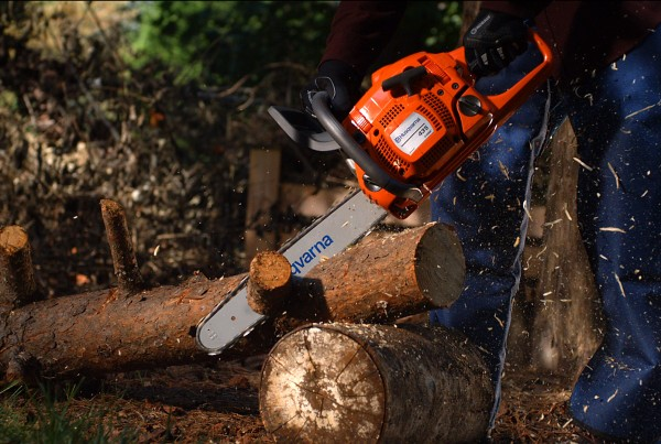 Chainsaw cutting wood in slow-motion